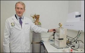 DEFRA minister Owen Paterson using a particle gun used in the testing of GM crops
